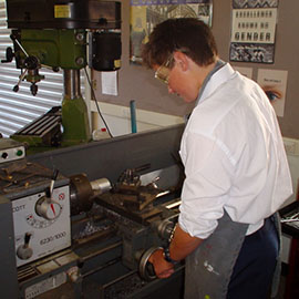 Student working with a lathe